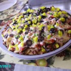 Italian Nachos Restaurant-Style - Italian sausage, pepperoni, banana peppers, mozzarella, and pizza sauce make for great nachos.