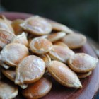 Roasted Pumpkin Seeds - Fresh pumpkin seeds are roasted with butter in salt to make this popular seasonal snack.