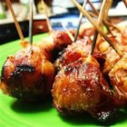 Bacon Wrapped New Potatoes - Bite size new potatoes are wrapped in bacon and grilled until the bacon is nice and crispy.  Serve this grilled appetizer with ranch dressing or BBQ sauce for dipping.
