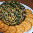 Country French Cheese - This bacon and cheddar cheese ball with a twist is rolled in chopped parsley and nuts.  Serve with crackers or sliced baguette.