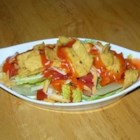 Spicy Mexican Salad - This salad couldn't be easier to make; everything  - lettuce, tomatoes, cheese, and beans - goes into one bowl and is tossed with a ready-made Catalina salad dressing and tortilla chips.