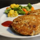 Grandma's Famous Salmon Cakes - Simple and tasty pan fried salmon cakes! Just salmon, eggs, onion and black pepper. Mix it all up, shape into patties and you are ready to go! Great with macaroni and cheese.