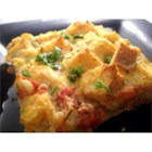 Oven Baked Omelet with Feta and Tomatoes - Briny feta cheese and smokey fire-roasted tomatoes transform eggs and bread into a breakfast masterpiece.
