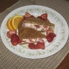 Toasted Strawberry-Cream Cheese Breakfast Sandwiches - Cinnamon raisin bread is topped with a white chocolate-cream cheese mixture and sliced strawberries. Pan-toasted, they're served drizzled with maple syrup.
