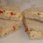 Best Farmers' Market Pimento Cheese - Scrumptious white Cheddar cheese combines with flecks of red onion, green onion, and pimento for the best pimento cheese ever.