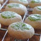 Lime Creams - Buttery little thumbprint cookies have a refreshing creamy lime-flavored center for a different taste and look on your holiday cookie tray.