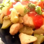 Chicken and Chayote - Pan-fried chicken and potatoes mix with chayote squash, onion, and garlic in this flavorful dish.