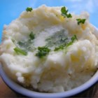 Potatoes Romanoff - Mashed potatoes are baked with sour cream, green onions and processed cheese for a stick to your ribs side dish your whole family will love.