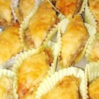 Baklava - This Near Eastern pastry is made of many layers of paper-thin dough with a filling usually of honey and ground nuts.  If you like honey, you'll probably like Baklava.