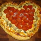 Valentine Pizza - Make this pizza for your Valentine! The rosemary dough is made in a bread machine, and then made into three heart shaped pizzas.