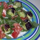 Aunt Karen's Brussels Sprouts Salad - Brussels sprouts make a different and interesting vegetable salad when combined with a simple vinegar and oil dressing, chopped tomato, and fresh parsley.