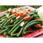 Holiday Green Beans - Green beans are tossed in butter, lemon, soy and garlic, with pimentos and peanuts, for a nice change from the traditional holiday green bean casserole.