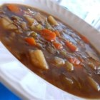 Beef and Barley Soup III - Shredded cabbage and red wine are added to this hearty soup in a beef broth made with pre-cooked beef, onions, celery, carrots, garlic, potatoes and barley.