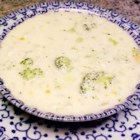 Cheese Soup with Broccoli - Broccoli florets, onion and shredded carrots in chicken broth are combined with a roux-thickened milk base in this cheese soup made with processed American cheese food.