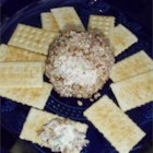 Ultimate Cheese Ball - This easy cheese ball is good for any occasion. The mixture may be formed into any shape (e.g., a log, a snowman). Serve with buttery, round crackers.