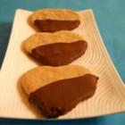 Muddy Hearts - Muddy Hearts is a perfect title for these festive chocolate-dipped peanut butter heart cookies.