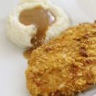 Lowfat Baked Chicken -  Lowfat yogurt gives plenty of zip and a corn flake coating adds crunch to this baked chicken dish.
