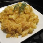 Mena's Baked Macaroni and Cheese with Caramelized Onion - Macaroni and cheese is raised to a new level with the sweetness of caramelized onions, the heat of cayenne pepper and mustard, and sharp, fresh cheeses. Vegetable broth can be substituted for chicken broth to make this a vegetarian dish.