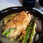 Asparagus and Mozzarella Stuffed Chicken Breasts - Skinless, boneless chicken breasts are pounded thin, rolled around fresh spears of asparagus with mozzarella cheese, and baked for an easy spring dinner that's ready in less than an hour.