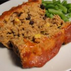 Lighter Mexican Meatloaf - Ground chicken and turkey, along with salsa and fire-roasted green chiles, give this light main dish loaf its color and Mexican-inspired flavor. Just mix it and bake it.