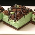 St. Patrick's Chocolate & Mint Cheesecake Bars - This mint flavored cheesecake filling is sandwiched between a rich chocolate crust and a layer of chocolate and mint chips. They are sure to please the whole family.