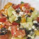 Sylvia's Easy Greek Salad - This is a classic, but easy Greek salad with a simple, simple dressing. Chop and dice all the veggies  - bell peppers, cucumbers, tomatoes, red onions, and olives. Then whip up the vinegar and oil dressing. Toss one with the other, and add crumbled feta cheese.