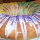 King Cake in a Bread Machine - Make your Mardi Gras king cake using your bread machine to mix and knead the dough. Fill the dough with a buttery cinnamon-pecan filling, bake, and decorate with a frosting glaze and the time-honored purple, green, and yellow colored sugar. It's traditional to stick a little plastic baby or a bean into the cake before baking. The lucky one whose slice has the prize gets to make the king cake next year.