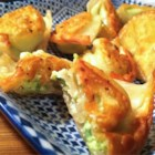 Edamame Dumplings - These dumplings are filled with pureed edamame, green onion, garlic, sour cream, and lemon juice.