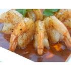 Tipsy Shrimp - These tangy shrimp are melt-in-your-mouth delicious.  They can be individually plated for the appetizer of a sit down dinner, or kept warm in a chafing dish at a buffet or cocktail party.  Simply insert a frilled toothpick in each shrimp and smother with the sauce!