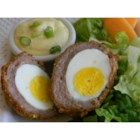Donna's Nest Eggs - Easy and delicious eggs coated in sausage are baked in the oven until browned. It's a perfect dish for your Easter brunch, for a fun breakfast anytime, and to take along with you for lunch.