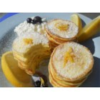 Romantic Lemon Cheesecake Pancakes - Light and delicate pancakes made with cream cheese, egg, and just a bit of flour and sugar are sprinkled with confectioners' sugar and drizzled with lemon juice for a romantic brunch item.