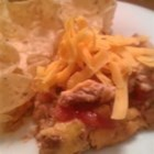 "The Best Taco Dip - This is a flavorful and spicy layered appetizer dish that you can serve with tortilla chips. It reheats wonderfully, if there's any left over! And that's a big ""if."""
