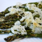 Broiled Asparagus Parmesan - Asparagus steamed and then broiled in the oven with a light dusting of Parmesan and lemon butter is a quick vegetable side dish for your dinner table.