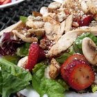 Spicy Strawberry Salad - Mushrooms, salad greens, chopped pecans, and lots and lots of fresh, sliced strawberries are all dressed with a poppy seed dressing in this fabulous taste sensation.  Makes eight generous servings.