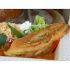 Authentic Mexican Chili Rellenos - Slightly spicy Anaheim chiles are stuffed with Mexican cheese, rolled in flour and beaten egg, and pan-fried until golden brown in this authentic recipe handed down for generations.