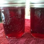 Raspberry Jalapeno Jelly - Homemade raspberry jam--made with fresh or frozen raspberries--is livened up with spicy jalapeno peppers.