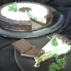 Chocolate Mint Cheesecake - This cheesecake is made with bittersweet chocolate. Beautiful garnished with fresh mint leaves.