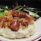 Sausage and Sauerkraut - Sauerkraut is slowly simmered with brown sugar and apple to mellow out the tangy flavor, then baked with bacon and kielbasa sausage for a hearty German-inspired main dish that will warm you up.