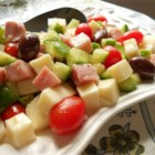 Cucumber and Ham Antipasto - Cucumbers, mozzarella cheese, and ham combine to make a simple and tasty appetizer.