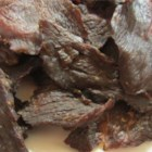 Sara's Beef Jerky - No smoker or dehydrator is required here. Thinly sliced sirloin or London broil steak is mixed with liquid smoke and seasonings, then baked at low temperature for 8 hours.