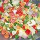 Summer Rainbow Salad - All the colors of the rainbow come together in this delicious medley of fresh fruit and vegetables to create a wonderful and refreshing taste. The homemade dressing makes it perfect.