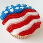 4th of July Star Cupcakes - Pretty chocolate cupcakes frosted with white frosting have a colorful star shape on top, made of blueberries and sliced strawberries.