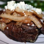 Smothered Filet Mignon - The filet mignon marinates in a mixture of balsamic vinegar and Dijon mustard while you are heating the grill and cooking the onions, and can be made in under an hour.  Serve with some mashed garlic red potatoes and sweetened green beans for a fabulous special occasion meal.