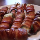 Grilled Bacon Jalapeno Wraps - Cream cheese-filled jalapeno poppers are wrapped with bacon and grilled for this easy party snack.