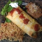 Beef Chimichangas - Simple, yummy beef and cheese chimichangas bake for only 15 minutes in a hot oven. Then just top with your favorite toppings, like lettuce, salsa, and sour cream for a fast dinner.