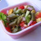 Green Bean Salad - Green beans, peas, corn, pimento, and other veggies marinate overnight in a tangy vinaigrette dressing.