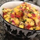 Fresh Mango Salsa - Lime juice and cider vinegar balance the sweetness of the tomatoes, onion, mango, and sugar in this salsa recipe.