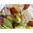 Fried Irish Cabbage with Bacon - Cabbage cooked cooked in bacon drippings and topped with crumbled bacon is a savory side dish.
