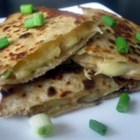 Apple Gouda Quesadillas - Wonderful change to a plain old quesadilla.  Sweet, salty and barbecued!  Use any type of firm red apple. Additional options: add barbecued chicken or chopped jalapeno peppers. Serve warm with sour cream, salsa, guacamole or all three.
