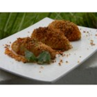 Crumby Potatoes - Potato halves are coated with a seasoned bread crumb mixture and baked until tender and delicious.